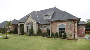 Photo - Johnston Builders built this home for the Pasrade of Homes at 12508 Deep Wood Creek Drive in the Hidden Creek addition, north of NW 122 and east of MacArthur Boulevard. <strong>Steve Gooch - The Oklahoman</strong>
