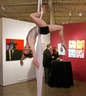 Photo - Kim Kieffer-Williams with Perpetual Motion Modern Dance performs as patrons look at art during Cafe City Arts 2008: Circus Maximus, City Arts Center's 15th annual fund-raiser, at the City Arts Center at State Fair Park in Oklahoma City, January 25, 2008. BY NATE BILLINGS, THE OKLAHOMAN ARCHIVES <strong>NATE BILLINGS - THE OKLAHOMAN</strong>