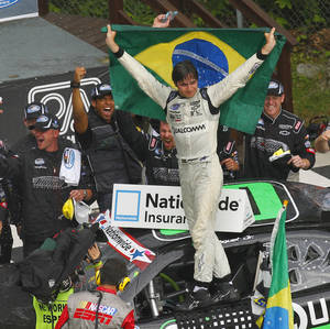 Photo -   Nelson Piquet Jr. celebrates in victory lane after winning the NASCAR Nationwide Series Sargento 200 auto race at Road America in Elkhart Lake, Wis, Saturday, June, 23, 2012. (AP Photo/Jeffrey Phelps)