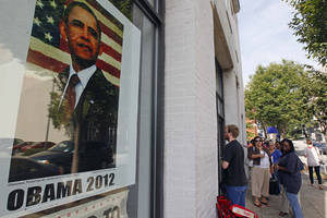 photo - People wait outside a campaign field office Thursday in Raleigh, N.C.,  to receive credentials for Charlotte's Democratic Convention. AP Photo