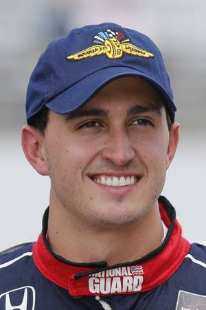 """Photo - In this May 17, 2014 photo, Graham Rahal poses for a photo after his qualification run on the first day of qualifications for Indianapolis 500 IndyCar auto race at Indianapolis Motor Speedway in Indianapolis. No single driver or team has risen to the top this season. And with so much attention on Kurt Busch, who will become just the fourth driver in history to compete in both the 500 and NASCAR's Coca-Cola 600 on the same day, so many other elements of this magical race at historic Indianapolis Motor Speedway have been somewhat overlooked. """"I don't know that there's a favorite at all this year,"""" said Rahal. """"I feel like it is extremely wide open at this point, even as a driver myself, I couldn't even tell you who I would pick. I have no clue."""" (AP Photo/Dave Parker)"""