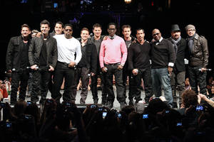 "Members of 98 Degrees, Boyz II Men, and New Kids on the Block, greet fans Tuesday during the announcement of ""The Package Tour,"" in New York. The summer tour will feature the three bands.  AP Photo/Starpix, Kristina Bumphrey"