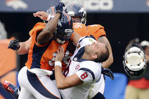 Photo -   In this Sunday, Sept. 23, 2012, photo, Denver Broncos linebacker Joe Mays, left, knocks Houston Texans quarterback Matt Schaub's helmet off on a hit during the third quarter of their NFL football game in Denver. Mays received a one-game suspension and a $50,000 fine from the NFL for the hit that dislodged Schaub's helmet and took off a piece of his ear. (AP Photo/The Denver Post, Joe Amon) MANDATORY CREDIT; MAGS OUT; TV OUT