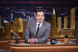 "Photo - In this photo provided by NBC, Jimmy Fallon appears during his ""The Tonight Show"" debut on Monday, Feb. 17, 2014, in New York. Fallon departed from the network's ""Late Night"" on Feb. 7, 2014, after five years as host, and is now the host of ""The Tonight Show,"" replacing Jay Leno after 22 years. (AP Photo/NBC, Lloyd Bishop)"