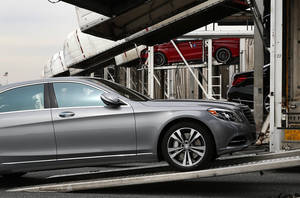 Photo - In this March 27, 2014 photo, a Mercedes-Benz sedan rolls onto a car-carrier at the company's Vehicle Processing Center in Baltimore. The Commerce Department issues its April report on wholesale stockpiles on Tuesday, June 10, 2014. (AP Photo/Patrick Semansky)