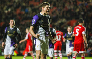 Photo - Liverpool's Steven Gerrard, centre, reacts after scoring a goal from a penalty shot,  during their English Premier League match against Southampton, at St Mary's, Southampton, England, Saturday March 1, 2014. (AP Photo/PA, Chris Ison) UNITED KINGDOM OUT