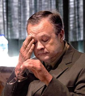 Photo - Roger Q. Melson Jr. wipes sweat from his face during his sentencing hearing for embezzlement on Nov. 9, 2010. <strong>JIM BECKEL</strong>