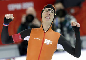 Photo - Gold medallist Jorrit Bergsma of the Netherlands celebrates after setting a new world record in the men's 10,000-meter speedskating race at the Adler Arena Skating Center during the 2014 Winter Olympics in Sochi, Russia, Tuesday, Feb. 18, 2014. (AP Photo/Matt Dunham)