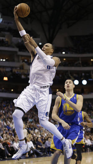 Photo - Dallas Mavericks forward Shawn Marion (0) shoots past Golden State Warriors guard Klay Thompson (11) during the second half of an NBA basketball game Saturday, Feb. 9, 2013, in Dallas. The Mavericks won 116-91. (AP Photo/LM Otero)