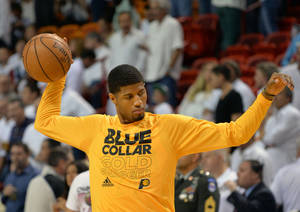 Photo - Jun 3, 2013; Miami, FL, USA; Indiana Pacers small forward Paul George prior to facing the Miami Heat in  game 7 of the 2013 NBA Eastern Conference Finals at American Airlines Arena. Mandatory Credit: Steve Mitchell- USA TODAY Sports