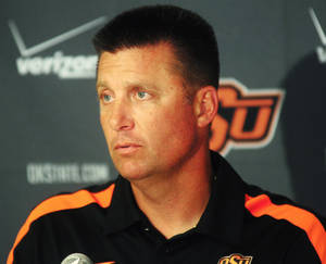 Photo - OKLAHOMA STATE UNIVERSITY / OSU / COLLEGE FOOTBALL: Oklahoma State coach Mike Gundy speaks to media members at the media luncheon on August 22, 2013 at Boone Pickens Stadium in Stillwater, Okla. Photo by KT King, For the Oklahoman KOD