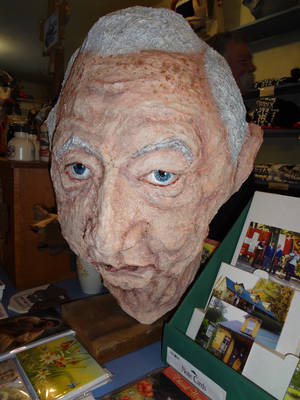 photo - A homemade mask of West Virginia's late U.S. senator, Robert C. Byrd, sits in the store and mask museum in Helvetia, W.Va., on Saturday, Feb. 9, 2013, where revelers were celebrating the annual Fasnacht festival. (AP Photo/Vicki Smith)