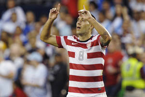 photo -   United States forward Clint Dempsey celebrates after scoring against Guatemala during the first half of a World Cup qualifying soccer match in Kansas City, Kan., Tuesday, Oct. 16, 2012. (AP Photo/Reed Hoffmann)