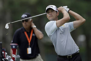Photo - Jesse Smith tees off on the eighth hole during practice for the U.S. Open golf tournament at Merion Golf Club, Wednesday, June 12, 2013, in Ardmore, Pa. (AP Photo/Julio Cortez)