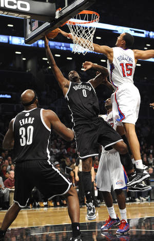 Photo -   Los Angeles Clippers' Ryan Hollins (15) blocks the shot of Brooklyn Nets' Andray Blatche (0) as Nets' Reggie Evans (30) watches in the first half of an NBA basketball game on Friday, Nov., 23, 2012, at Barclays Center in New York. (AP Photo/Kathy Kmonicek)