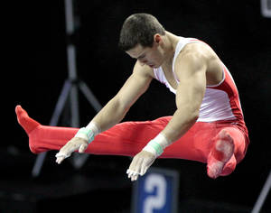 Photo - COLLEGE GYMNASTICS: The University of Oklahoma's Jake Dalton competes in the high bar at the event finals of the men's NCAA Men's Gymnastics Championships at the Lloyd Noble Center on Saturday, April 21, 2012, in Norman, Okla.  Photo by Steve Sisney, The Oklahoman