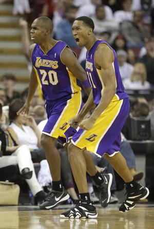 Photo - Los Angeles Lakers' Jodie Meeks, left, and Wesley Johnson celebrate after Meeks scored a three-point shot in the closing moments of an NBA basketball game against the Sacramento Kings in Sacramento, Calif., Friday, Dec. 6, 2013.  The Lakers won 106-100.(AP Photo/Rich Pedroncelli)