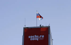 Photo - A Russian flag flutters over the ski jumping venue prior to the 2014 Winter Olympics, Tuesday, Feb. 4, 2014, in Krasnaya Polyana, Russia. (AP Photo/Gregorio Borgia)
