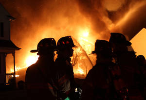 photo -   Firefighters battle an early morning blaze Tuesday May 1, 2012, that killed a veteran police captain, his wife and two teenage daughters when fire that swept through their home in Carmel, N.Y. Larchmont, N.Y. police identified the dead as Thomas Sullivan of the Larchmont police, his wife, Donna, and their two daughters. A son escaped from the burning Carmel home in Putnam County, about 60 miles north of New York City. (AP Photo/The Journal News, Frank Becerra Jr) NYC METRO OUT; TV OUT; MAGS OUT; NO SALES