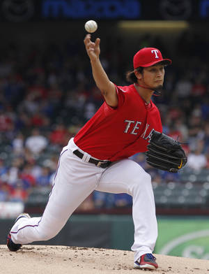 Photo -   Texas Rangers starting pitcher Yu Darvish (11) of Japan throws against the Los Angeles Angels during the first inning of game one of a baseball double header Sunday, Sept. 30, 2012, in Arlington, Texas. (AP Photo/LM Otero)