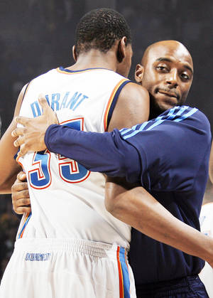 Photo - Thunder guard Damien Wilkins, right, joined Kevin Durant, left, in the starting lineup when Scott Brooks took over as coach.Photo BY NATE BILLINGS, THE OKLAHOMAN