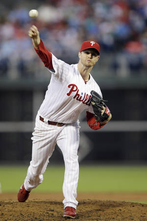 Photo - Philadelphia Phillies' Kyle Kendrick pitches in the third inning of a baseball game against the Chicago Cubs, Tuesday, Aug. 6, 2013, in Philadelphia. (AP Photo/Matt Slocum)