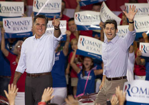Photo -   Republican presidential candidate Mitt Romney, left, and his vice presidential running mate Rep. Paul Ryan, R-Wis., arrive at a campaign rally Sunday, August 12, 2012 in Mooresville, N.C. at the NASCAR Technical Institute. (AP Photo/Jason E. Miczek)