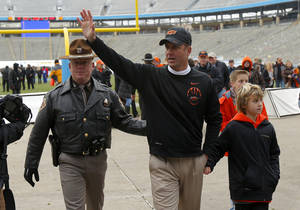 Photo - Oklahoma State coach Mike Gundy waves to the crowd after the Heart of Dallas Bowl football game between Oklahoma State University and Purdue University at the Cotton Bowl in Dallas, Tuesday, Jan. 1, 2013. Oklahoma State won 58-14. Photo by Bryan Terry, The Oklahoman