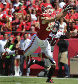 Photo -   Kansas City Chiefs tight end Kevin Boss (80) catches a touchdown pass while covered by Atlanta Falcons cornerback Brent Grimes (20) during the first half of an NFL football game at Arrowhead Stadium in Kansas City, Mo., Sunday, Sept. 9, 2012. (AP Photo/Ed Zurga)