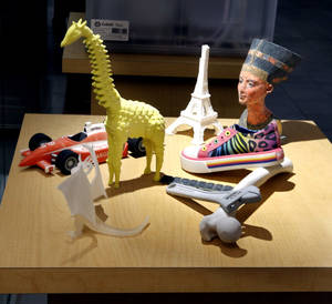 "Photo - Items printed with ""desktop"" 3D printers are shown in the One University area at the University of Oklahoma (OU) is seen in the Student Union on Tuesday, Oct. 1, 2013 in Norman, Okla.   Items at the store include different gadgets including 3D printers and interactive walls.   Photo by Steve Sisney, The Oklahoman"