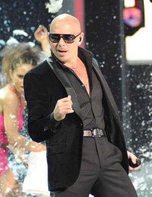 Photo -   Pitbull performs onstage at the 13th Annual Latin Grammy Awards at Mandalay Bay on Thursday, Nov. 15, 2012, in Las Vegas. (Photo by Al Powers/Powers Imagery/Invision/AP)