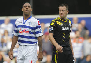 Photo -   Queens Park Rangers' Anton Ferdinand, left, is marked by Chelsea's John Terry as Chelsea defend a corner during their English Premier League soccer match at Loftus Road stadium, London, Saturday, Sept. 15, 2012. (AP Photo/Sang Tan)