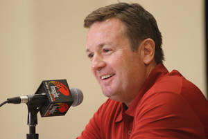 Photo - Oklahoma head coach Bob Stoops talks with the media during a University of Oklahoma media day for the Insight Bowl at the Camelback Inn in Paradise Valley, Ariz.,  Wednesday, Dec. 28, 2011. Photo by Sarah Phipps, The Oklahoman