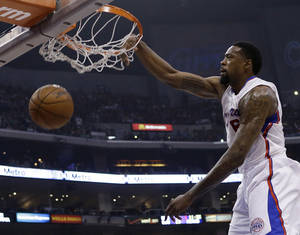 Photo - Los Angeles Clippers center DeAndre Jordan (6) dunks against the New York Knicks in the first half of an NBA basketball game in Los Angeles Sunday, March 17, 2013. (AP Photo/Reed Saxon)