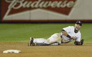 photo -   New York Yankees shortstop Derek Jeter reacts after injuring himself in the 12th inning of Game 1 of the American League championship series against the Detroit Tigers early Sunday, Oct. 14, 2012, in New York. (AP Photo/Paul Sancya )