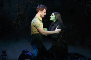 Photo - Fiyero (David Nathan Perlow) and Elphaba (Jennifer DiNoia) share an intimate moment together.   Photo by Joan Marcus <strong>©2013 Joan Marcus</strong>