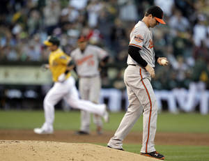 Photo -   Baltimore Orioles' Zach Britton, right, turns his back as Oakland Athletics' Stephen Drew rounds the bases after Drew hit a home run off Britton in the third inning of a baseball game Saturday, Sept. 15, 2012, in Oakland, Calif. (AP Photo/Ben Margot)