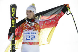 Photo - Germany's Maria Hoefl-Riesch poses for photographers on the podium after winning the silver medal in the women's super-G at the Sochi 2014 Winter Olympics, Saturday, Feb. 15, 2014, in Krasnaya Polyana, Russia. (AP Photo/Gero Breloer)