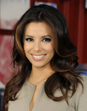 "Photo -   FILE - In this April 6, 2012 file photo, actress Eva Longoria appears for the new Pepsi Next in New York's Times Square. Lifetime is picking up ""Devious Maids,"" a new series from ""Desperate Housewives"" creator Marc Cherry. Eva Longoria is among the executive producers. (AP Photo/Evan Agostini, File)"