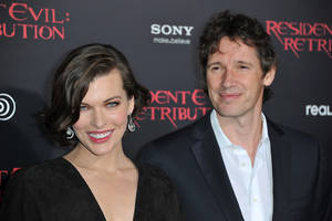 "photo -   Milla Jovovich, left, and Paul W.S. Anderson attend the US premiere of ""Resident Evil: Retribution"" at Regal Cinemas L.A. Live on Wednesday, Sept. 12, 2012 in Los Angeles. (Photo by Richard Shotwell/Invision/AP)"