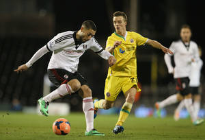 Photo - Fulham's Clint Dempsey, left, shields the ball from Sheffield United's Stefan Scougall during their 4th round replay English FA Cup soccer match between Fulham and Sheffield United at Craven Cottage stadium in London, Tuesday, Feb. 4, 2014. (AP Photo/Alastair Grant)