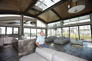 photo - Larry Waters shows the entertaining area of his Clark Building in downtown Oklahoma City, OK, Tuesday, September 25, 2012.  By Paul Hellstern, The Oklahoman