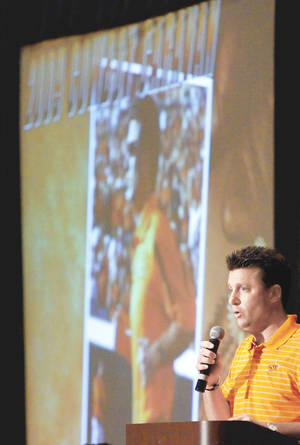 Photo - OSU football coach Mike Gundy speaks to a crowd during a Cowboy Caravan stop at the Cox Convention Center on Friday.  (Photo by Bryan Terry, The Oklahoman)