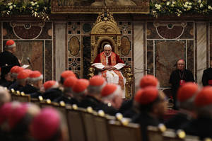 Photo - Pope Benedict XVI, center, delivers his message Monday on the occasion of the traditional exchange of Christmas greetings to the Curia, in the Regia Hall, at the Vatican. AP photo