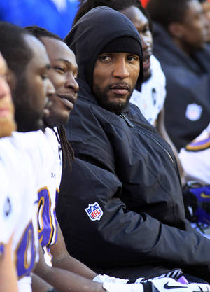 Photo - Baltimore Ravens inside linebacker Ray Lewis sits on the bench in the second half of an NFL football game against the Cincinnati Bengals, Sunday, Dec. 30, 2012, in Cincinnati. (AP Photo/Tom Uhlman)