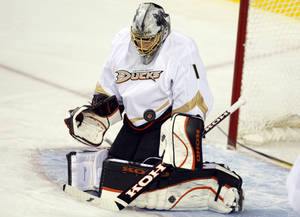 Photo -   Anaheim Ducks goalie Jonas Hiller, from the Czech Republic, stops a shot during first period NHL hockey action against the Calgary Flames in Calgary, Alberta, Saturday, April 7, 2012. (AP Photo/The Canadian Press, Jeff McIntosh)