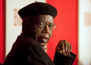 photo - This 2010 photo provided by Brown University shows Chinua Achebe on campus in Providence, R.I. Achebe, an internationally celebrated Nigerian author, statesman and dissident, has died at age 82. He joined Brown University in 2009 as a professor of languages and literature. (AP Photo/Brown University, Mike Cohea)