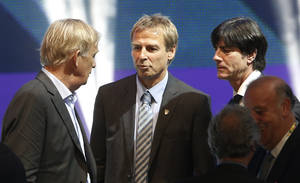 Photo - Cameroon head coach Volker Finke from Germany, United States head coach Juergen Klinsmann from Germany and Germany head coach Joachim Loew, from left, chat after the draw ceremony for the 2014 soccer World Cup in Costa do Sauipe near Salvador, Brazil, Friday, Dec. 6, 2013. (AP Photo/Silvia Izquierdo)