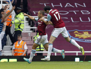Photo - West Ham United's Joe Cole, left, celebrates his goal against Cardiff City with teammate Joey O'Brien during their English Premier League soccer match at Upton Park, London, Saturday, Aug. 17, 2013. (AP Photo/Sang Tan)