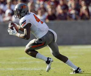 photo - Oklahoma State&#039;s Justin Gilbert intercepts a pass in the second half of the Cowboys&#039; win over Texas A&amp;M on Saturday. Photo by Sarah Phipps, The Oklahoman